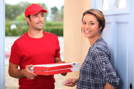 fast delivery: young man delivering pizza Stock Photo