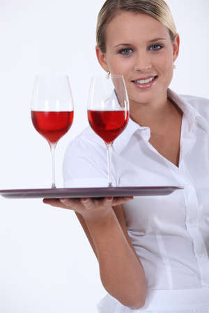 steward: Sommelier with two glasses of red wine