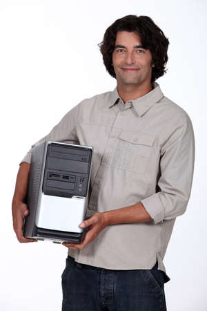 repair computer: man holding a computer tower