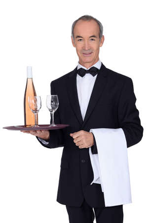 Senior waiter holding tray photo