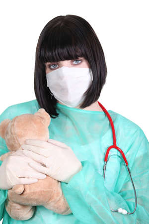 paediatrician: Female doctor holding teddy bear