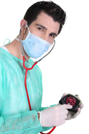 a surgeon auscultating a purse Stock Photo - 17386851