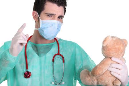 reprimanding: Doctor admonishing a teddy bear Stock Photo