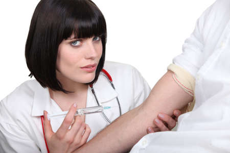 flu shot: Doctor giving her patient a shot Stock Photo