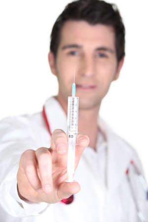 needle syringe infection: Doctor with an hypodermic needle