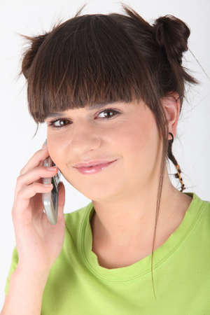 unorthodox: Teenage girl making phone call