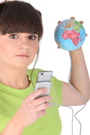 evoke: Teenager with mobile and globe