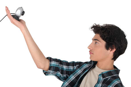 Teenager holding a webcam photo