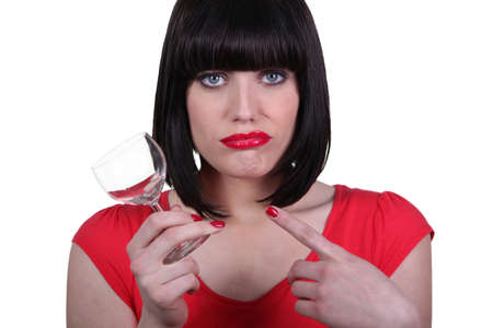 attractive woman holding an empty glass photo