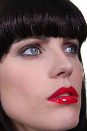 red lip: Woman wearing bright red lipstick