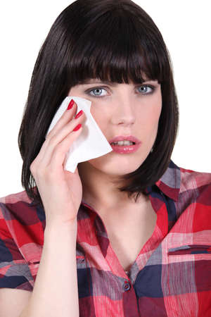 Woman wiping away a tear photo
