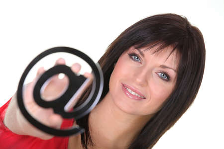 Woman holding an @ sign Stock Photo - 17385726