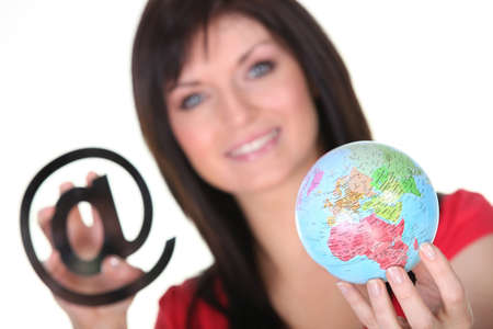 Woman with at sign and globe Stock Photo - 17385792