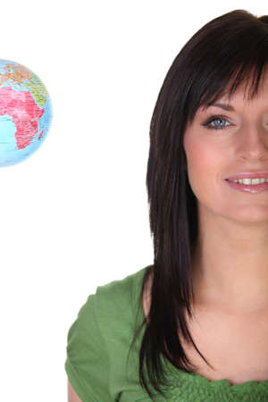 Brunette holding small globe photo