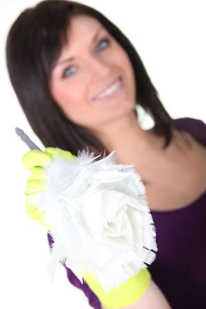 Brunette holding a duster photo