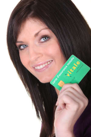 Woman showing her health card Stock Photo - 17385718