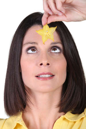 Woman holding a star Stock Photo - 17385623