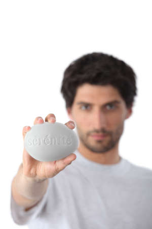 soaping: Man holding a bar of soap