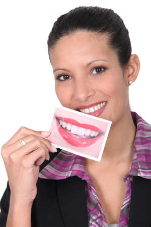 idealism: woman smiling and showing a perfect smile picture Stock Photo