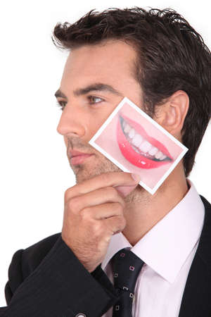 Man holding photo of mouth Stock Photo - 17385622