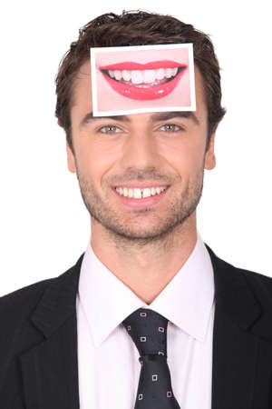 pearly: Businessman with a photograph of lips on his forehead