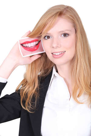 Redhead girl smiling with photo of a mouth Stock Photo - 17385624