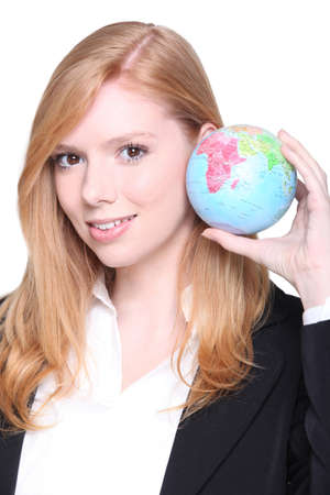 online internet presence: Young businesswoman holding a miniature globe Stock Photo