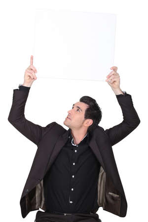 sharply: Sharply dressed man holding a board left blank for your message Stock Photo