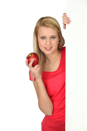 weight reduction plan: young woman holding an apple