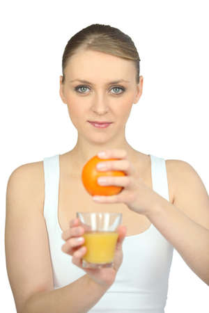 young woman pressing an orange photo