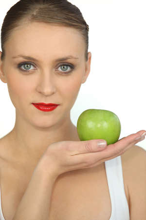 beauteous: graceful ballerina with bright red lipstick holding green apple