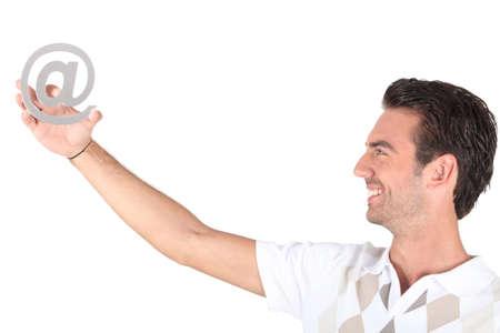 e mailing: Man holding at symbol Stock Photo