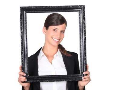 Businesswoman holding picture frame Stock Photo - 17386162