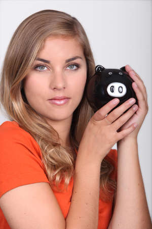 Woman with a piggy bank Stock Photo - 17386018