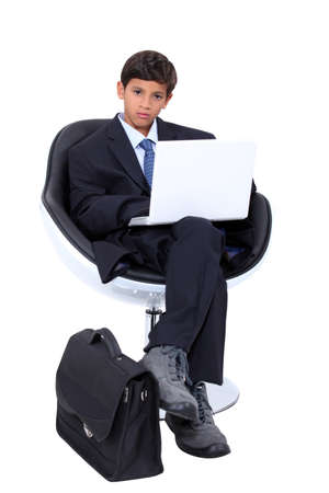 Boy dressed as a businessman photo