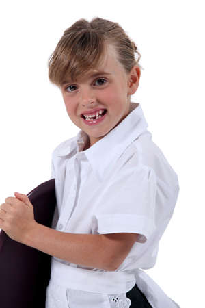 make belief: A young child pretending to be a waitress