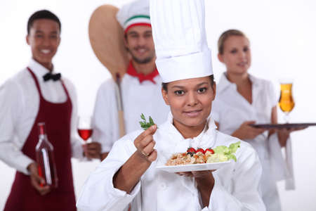 female chef presenting a plate photo