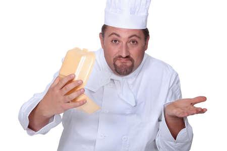 raised eyebrows: Chef holding burger box Stock Photo