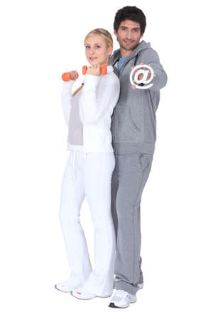 adherent: a couple doing fitness, the man is taking an  @  Stock Photo