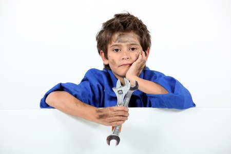 Boy dressed as a dirty mechanic