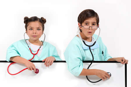 Children dressed as doctors photo