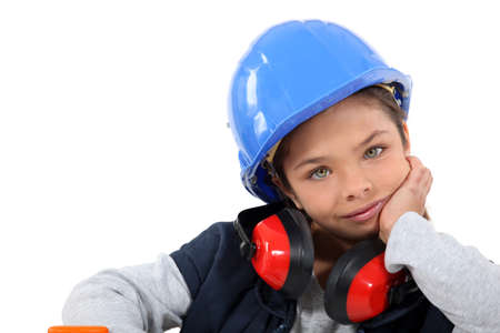 ear protection: Little girl dressed as construction worker