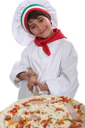 little dough: Little boy dressed as pizza chef