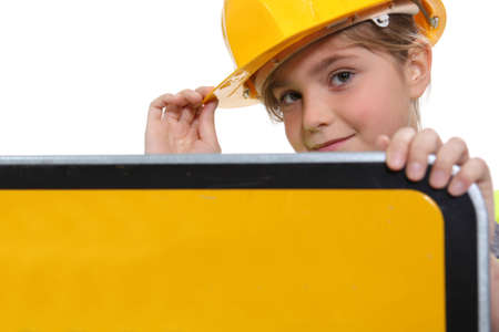 little girl dressed as a security road worker Stock Photo - 17385275