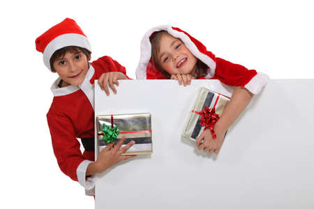 Children dressed as Santa Claus photo