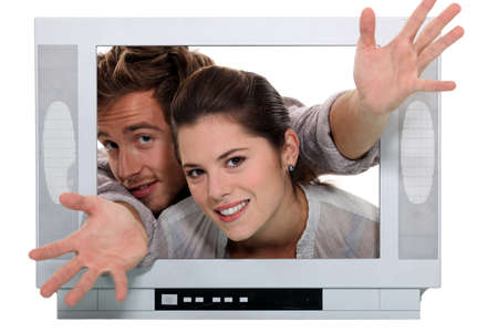 popping out: Couple popping out the TV