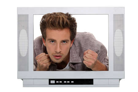 dissension: angry man behind a screen Stock Photo