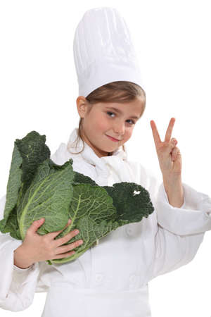 schoolgirl dressed as a cook photo
