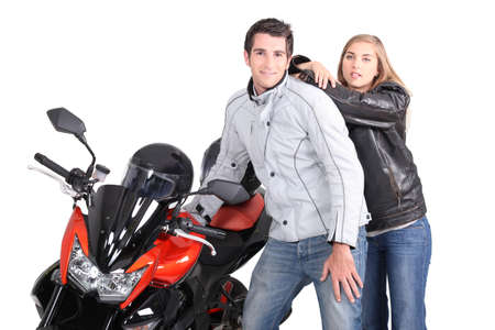motor cycle: Couple posing next to motorcycle