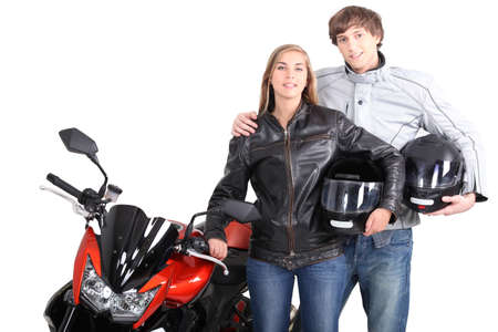crouching: Couple stood with motorcycle
